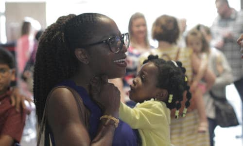 Photo of a mother and daughter talking after a Hope Church service