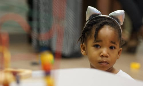 Photo of a Hope Kids child wearing silly cat ears
